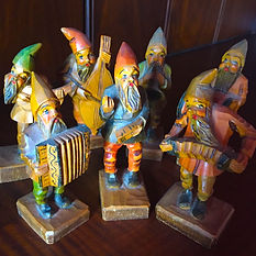Collection of seven wooden carved gnomes to inspire creativity