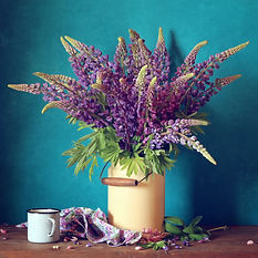 Still life of jug of purple flowers and a mug to inspire creativity