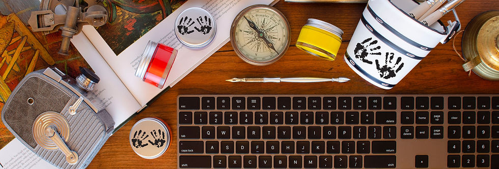 Creativity blog for inspiration with keyboard surrounded by acrylic paint pots, paint brushes, compas, stylus, camera, art book