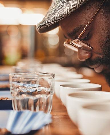 African man enjoying the aroma of fresh