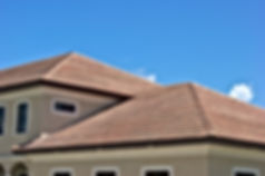 Half round clay tile roof tops on generi