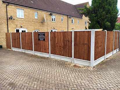 Fencing Contractor Clacton sign placedon wooden fencng of residential home in Clacton