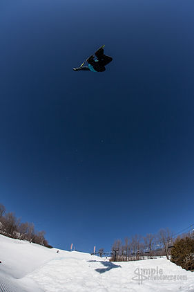senders society snowboarding camp and coaching devon jack big air grab trick