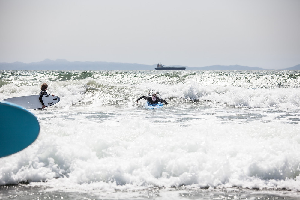 Devon Jack Paddling into one of his first ever waves on another type of board while running a team trip to California