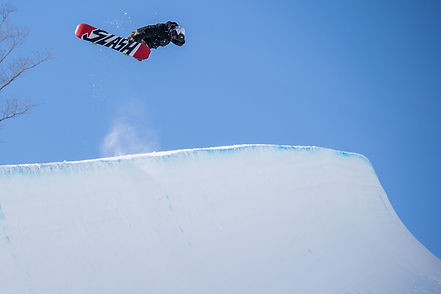 senders society snowboarding coach sam marcotte grab in the air