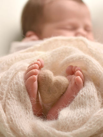 Photograph of baby girl's feet by Specialist Newborn Photographer, Hull and East Yorkshire and North Lincolnshire