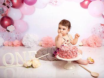 Little girl eating cake on her 1st birthday by Cake Smash Photographer in East Yorkshire near Hull 17