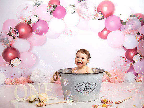 Image of little girl in bath surrounded by bubbles by Cake Smash Photographer in East Yorkshire near Hull