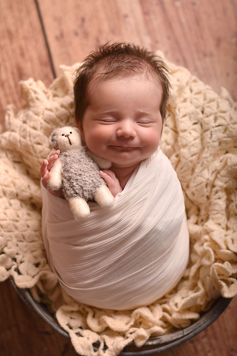 Photograph of smiling newborn girl by Specialist Newborn Photography, North Ferriby, Hull, East Yorkshire