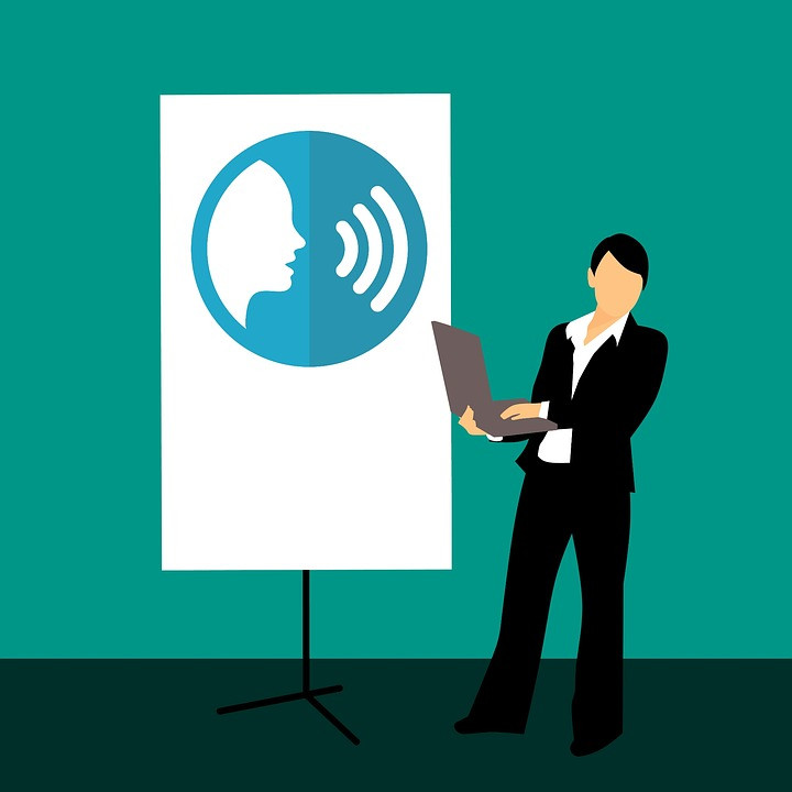 An illustration of a woman in a suit doing a presentation on communication skills.