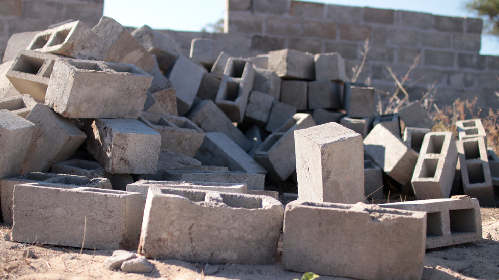 Cinder blocks used in construction at a new house being built in Luwingu