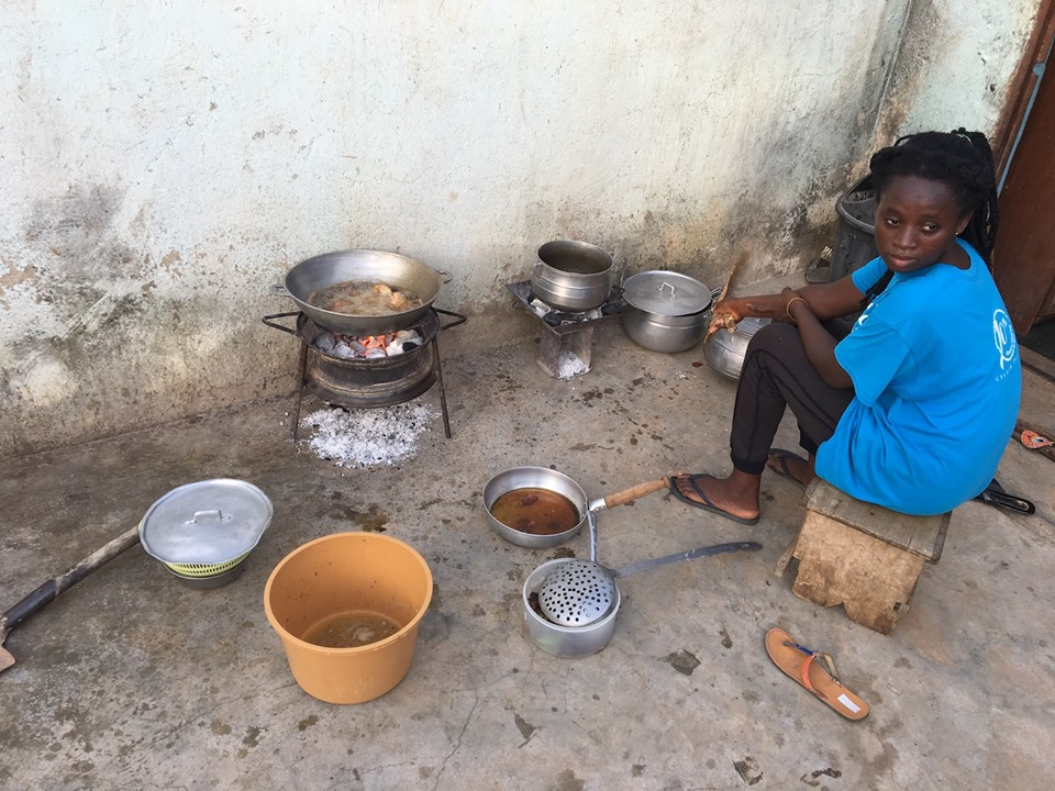 Preparing supper at the Aputara home! It was tasty good! — in Navrongo.