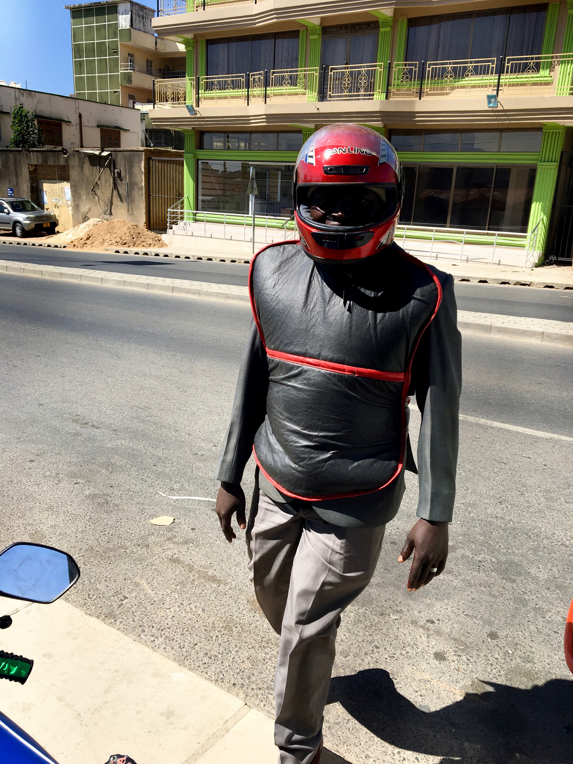 Pastor Brown Kyando in his motorcycle gear, ready to lead us over to the church.