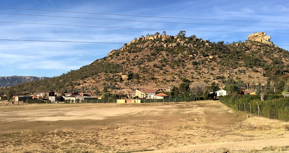 Another soccer pitch. You can barely see the goal on the right side of the open area. — in Maseru, Lesotho.
