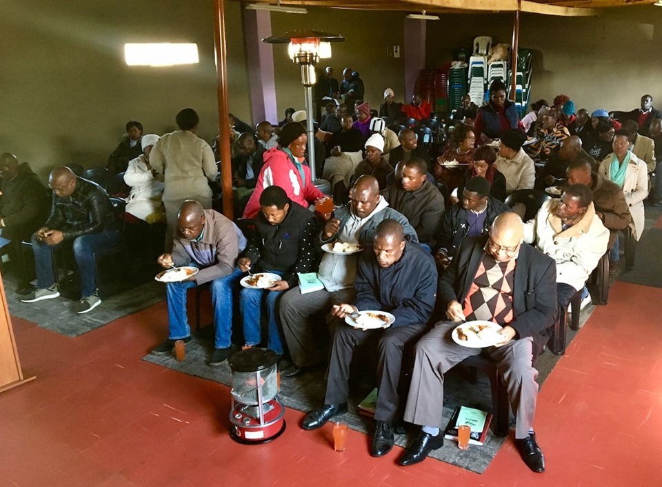 Pastors & Leaders sharing lunch together. — in Maseru, Lesotho.