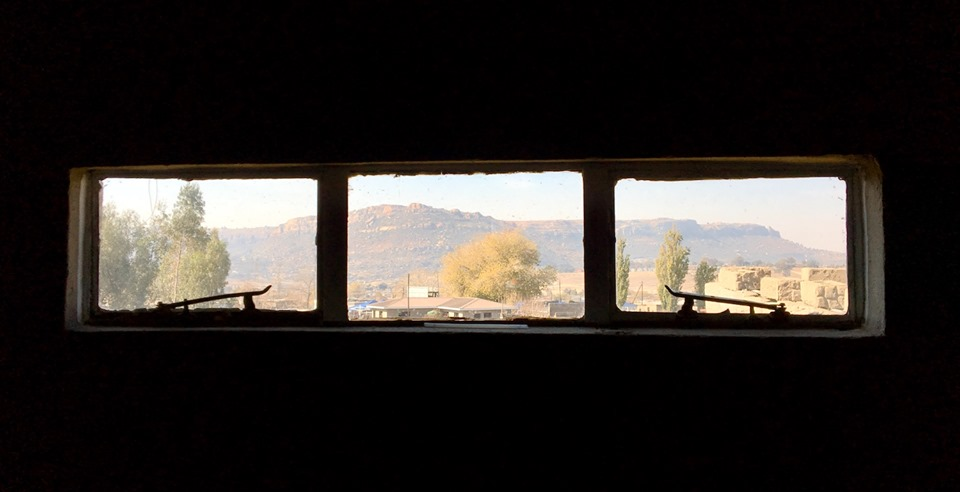View through the side window of the church. — in Maseru, Lesotho.