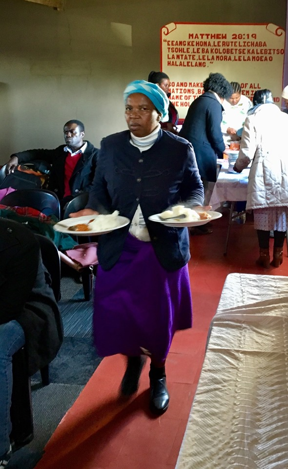 One of the faithful servants caring for everyone else. Like most people who serve, she was not really excited about having her photo taken in action. :-) — in Maseru, Lesotho.