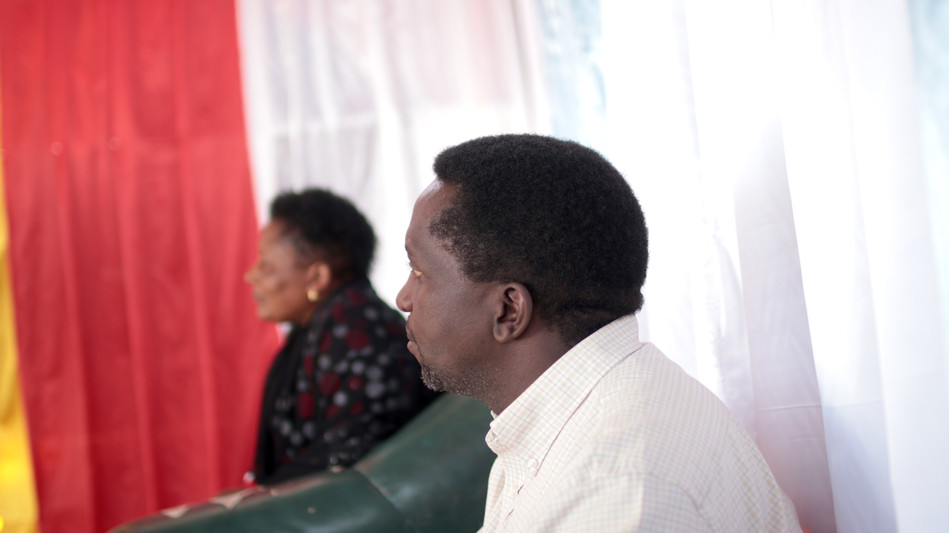 Pastor Enoch and Victoria (Azikiwe's wife) listening intently