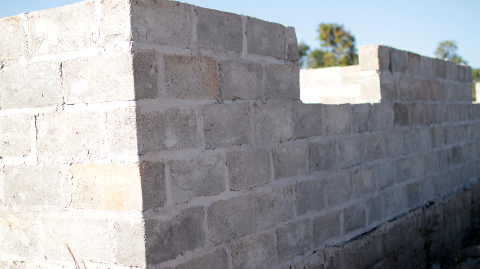 Typical structure in Zambia (houses, businesses, etc) are constructed of cinder blocks or burned bricks.  The bricks are hand-formed from local clay and do not last as well.  The practice is shifting to cement.