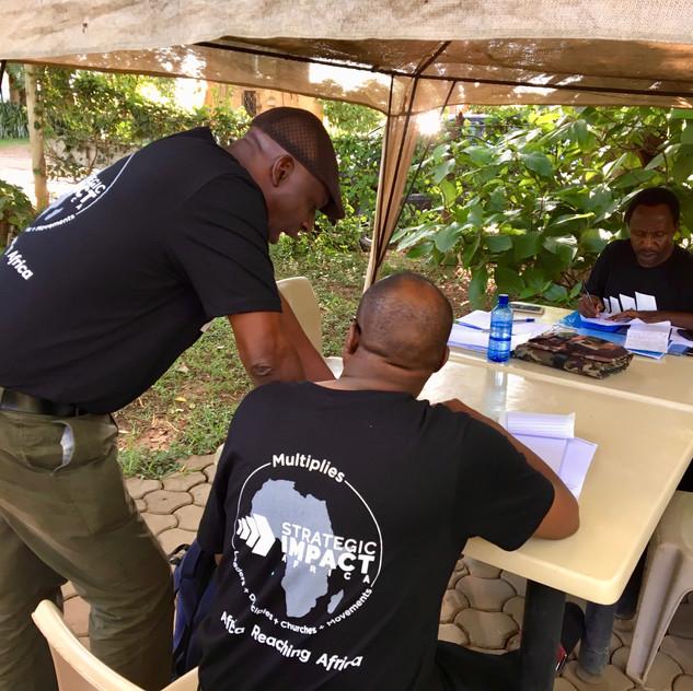 Sub-Saharan NE Sub-Region Team making plans for the year.  Israel Wandamba, Azikiwe Lutufyo, Reuben Mwambola