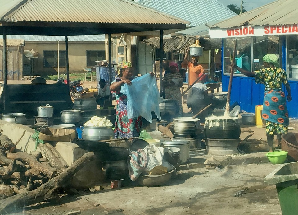 """""""Commercial kitchen"""" by the road. Cooking fufuo, banku, rice, and some other items."""