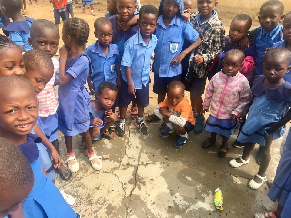 Some of the students at the school which Stephen started years ago were fascinated with a LONG worm that squirmed up after the heavy rains that morning. — in Navrongo.