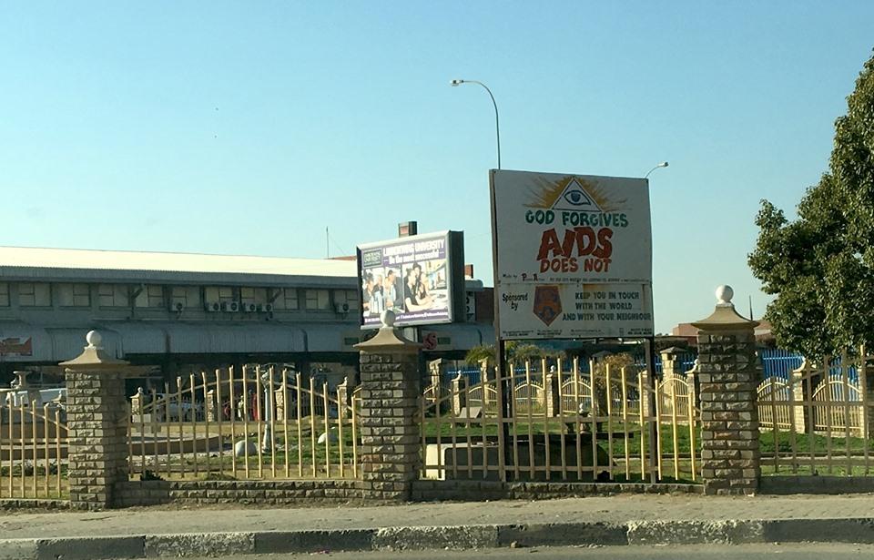 Billboard near downtown. — in Maseru, Lesotho.