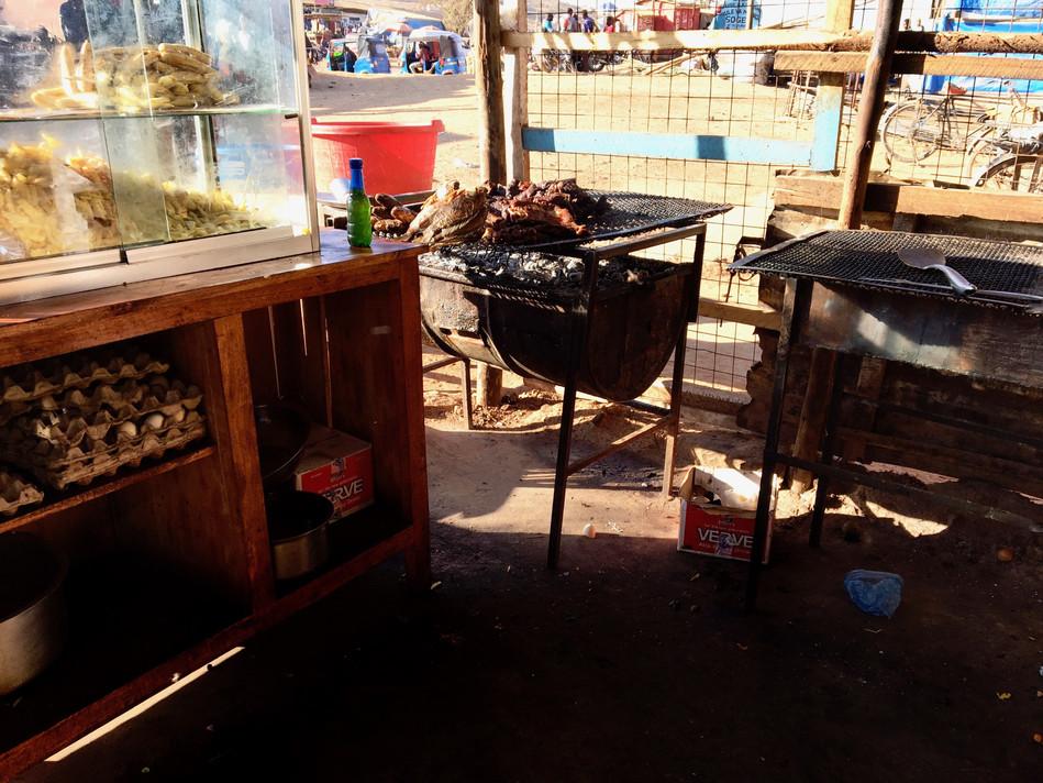 An open air restaurant's kitchen in our evangelism area