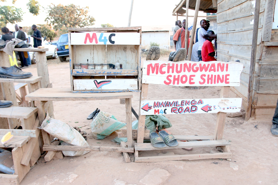 "A shoe shine and repair ""shop"""