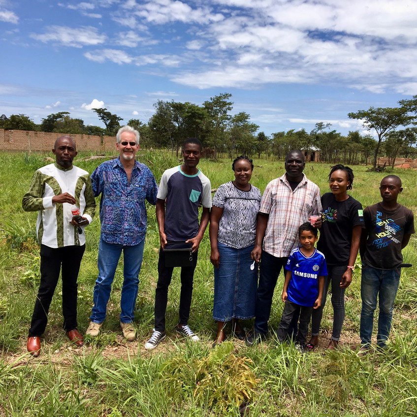 Some of our team in Luwingu standing on the property.