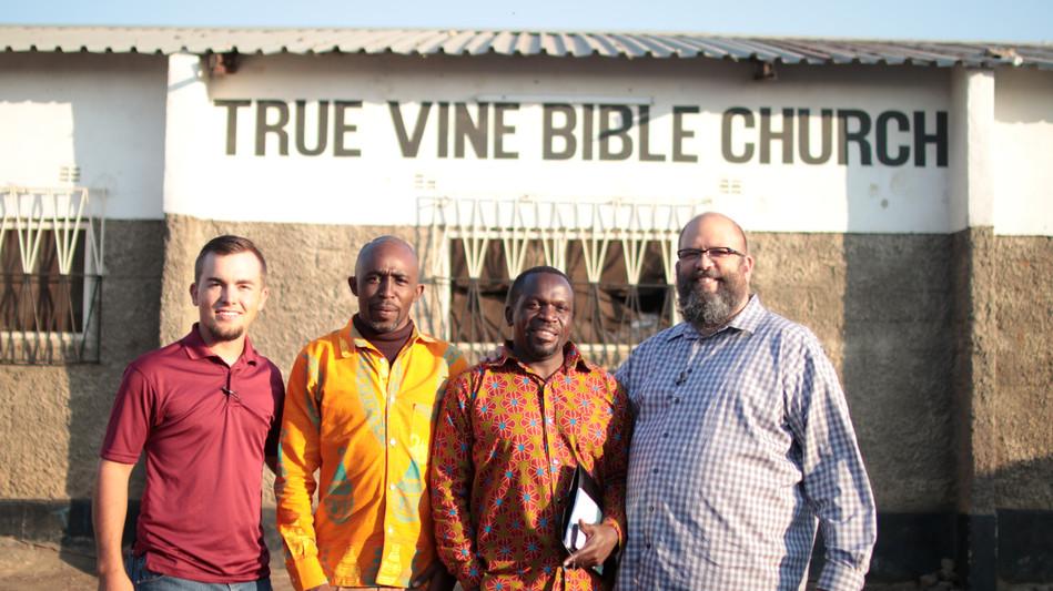 Josh Phipps, Dennis Sitali, Pastor Njovu, and I