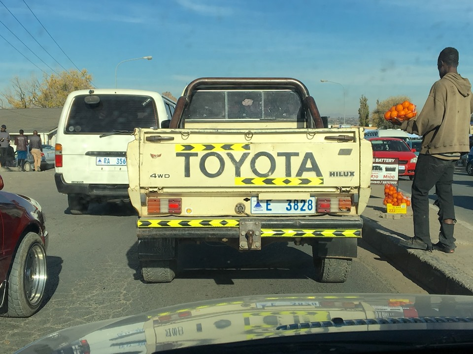Stuck in traffic... so another observation of what is normal here. The trailer hitch ball on this truck is the normal way they mount here. The circle above it is the trailer lights plug. — in Maseru, Lesotho.