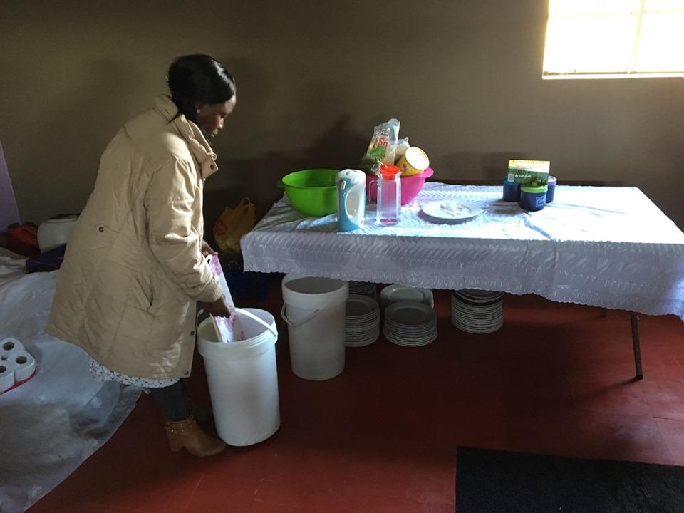 Alice preparing for tea time. — in Maseru, Lesotho.