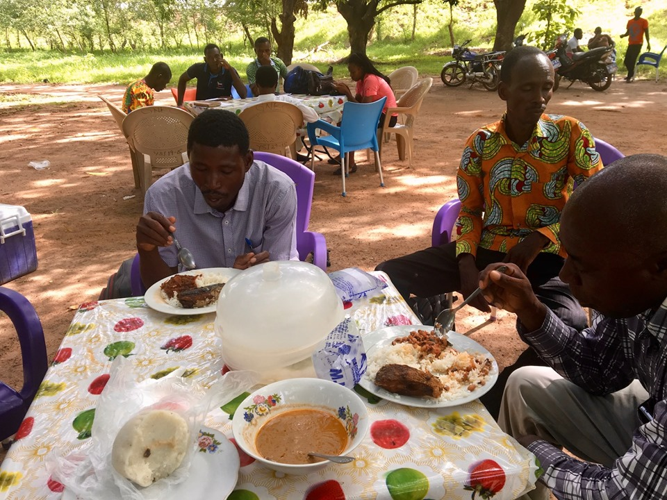 Lunch with the guys. Rice balls, sauce, Banku & Tilapia, rice & tomato sauce, other fish. — with Victor Ouedraogo and Alemya Edward in Sandema Balansa, Upper East, Ghana.