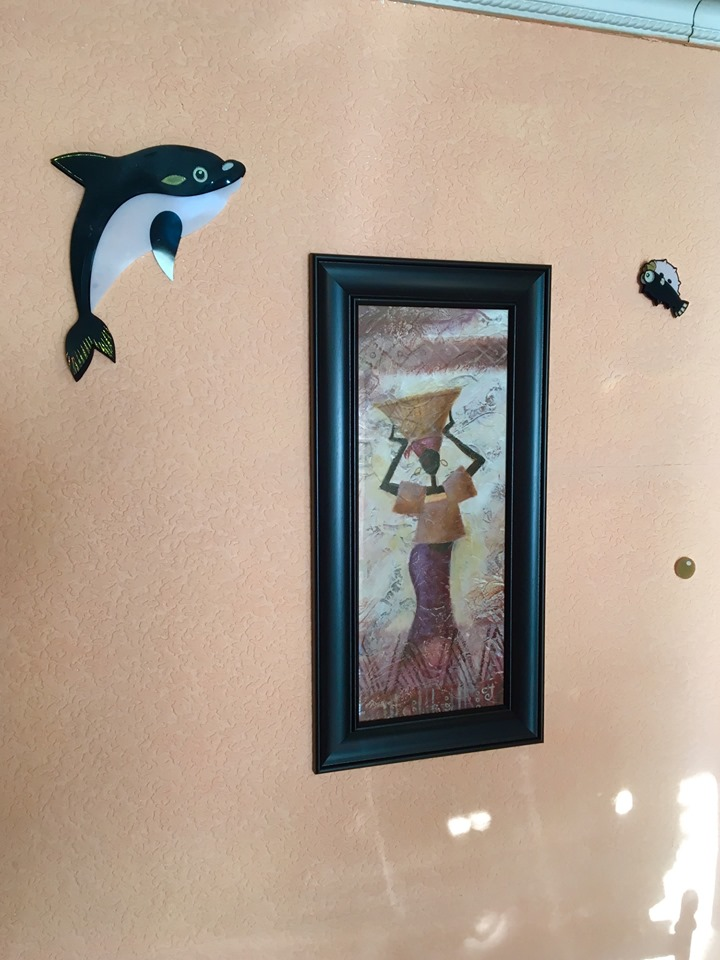 Of course you would combine African art with a killer whale colored dolphin and blowfish in a land-locked country! — at RIO GUEST HOUSE.