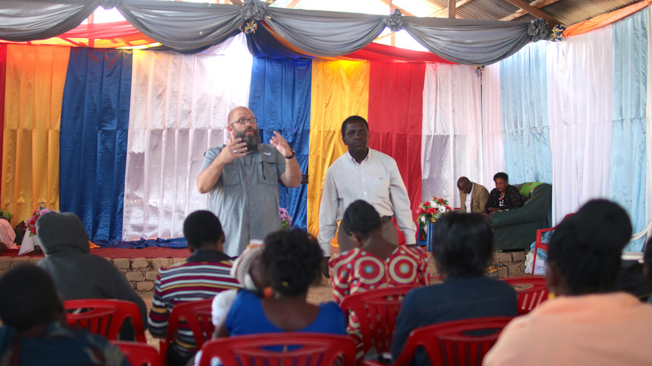 Teaching the pastors and leaders involved in the Mbeya area team with SI.