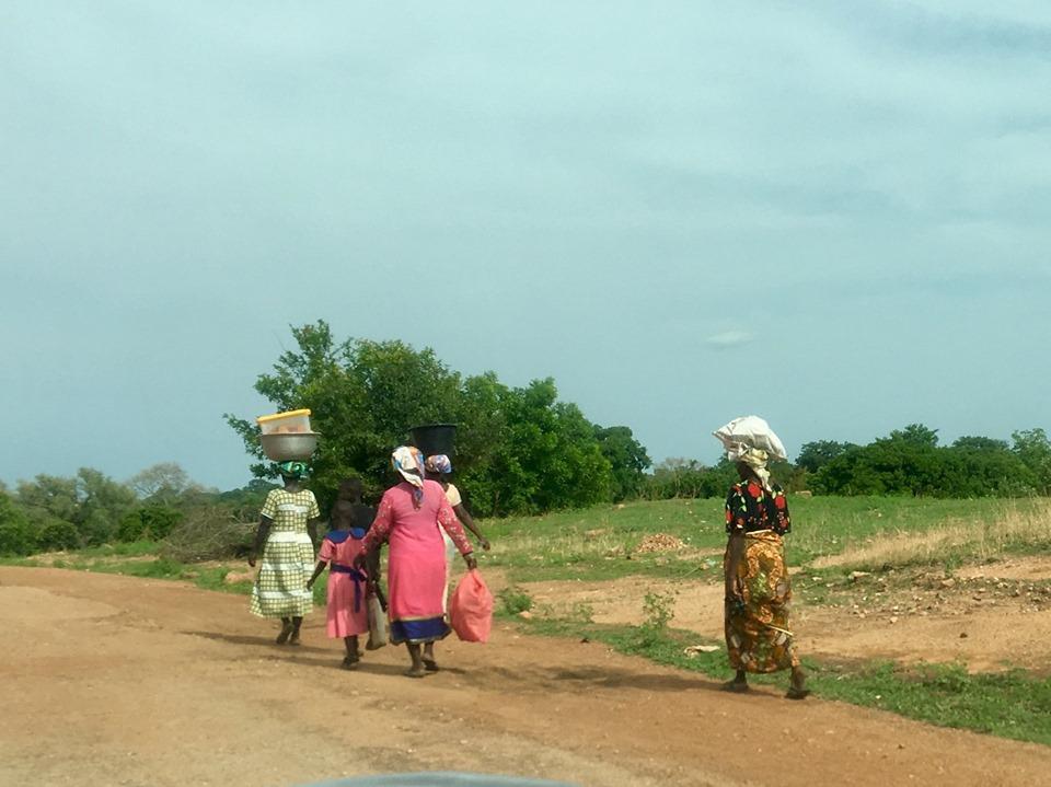 Heading home from market day in Chiana. — in Chiana Asunia, Upper East, Ghana.