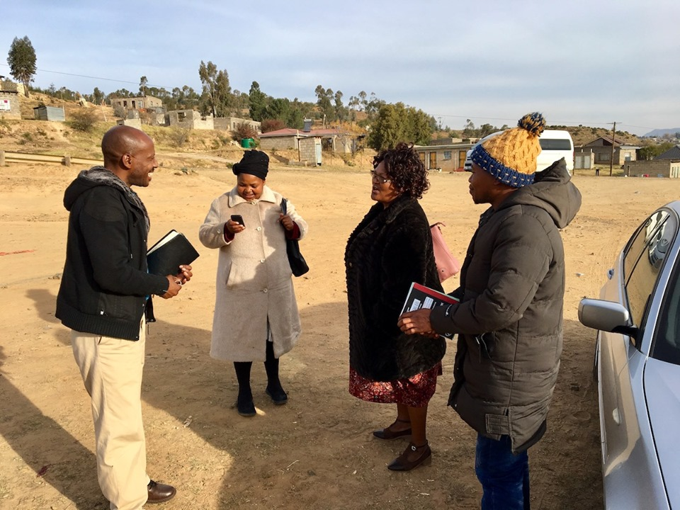 Our team talking before breaking into 2 groups and going into the neighborhoods. — in Maseru, Lesotho.