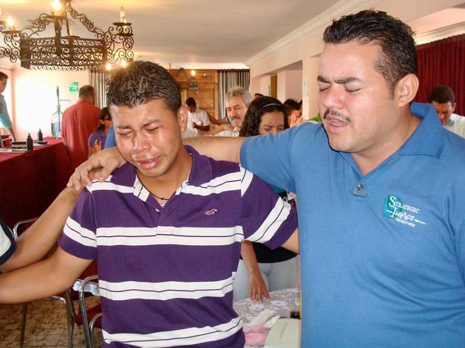 Praying with others in Barquisimeto, Venezuela