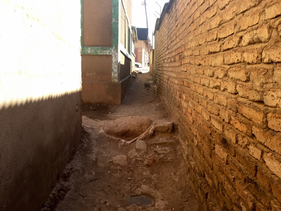The alleyway leading to the church from the main road