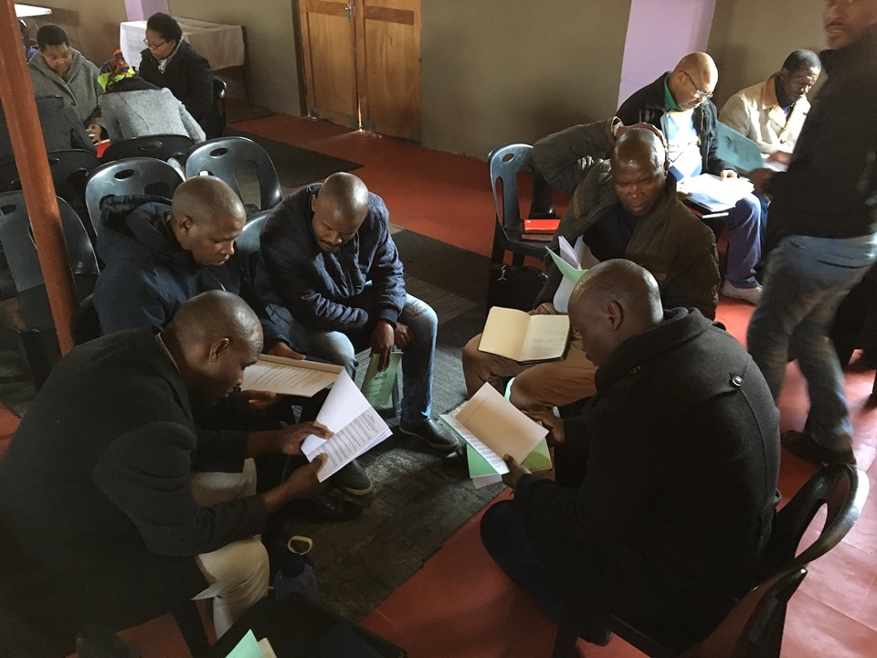Pastors & Leaders progressing through a sample exercise from the School of Multiplying Church Planters to gain experience as to how it functions. — in Maseru, Lesotho.