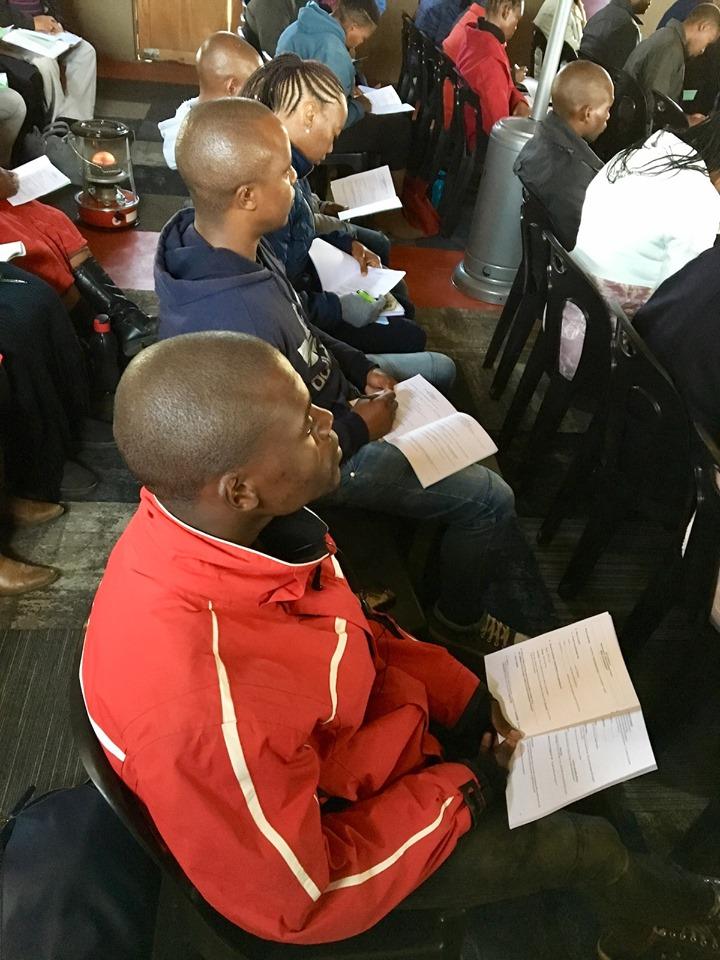Listening through the training. — in Maseru, Lesotho.