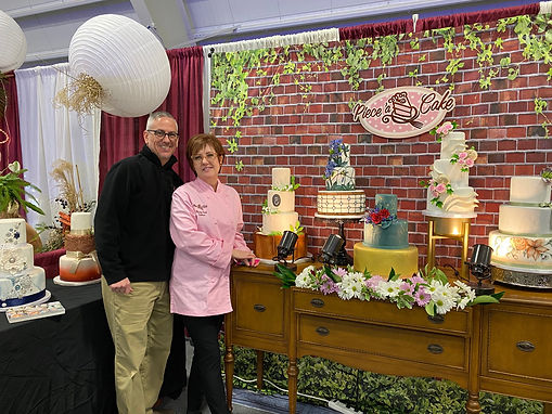 Owners Colleen and Terry Laky stand with their collection of cakes at a bridal show in the Lehigh Valley