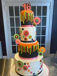 Neon Pinwheel Drip Birthday Cake