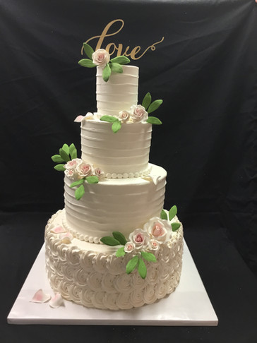Ivory Rosette and Knife-Dragged Buttercream Traditional Wedding