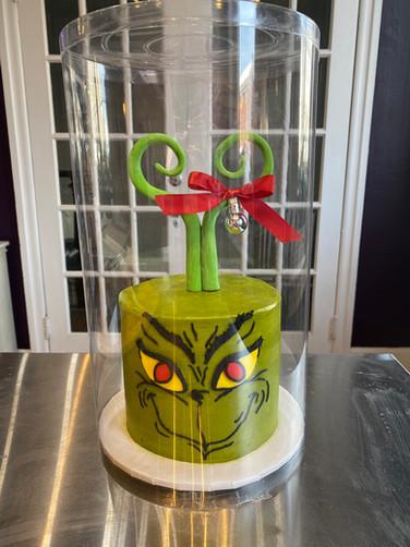 Grinch's Smirk Holiday Cake