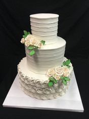 White Rosette and Knife-Dragged Buttercream Traditional Wedding