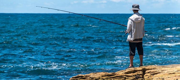 man sea fishing from rocks.jpg