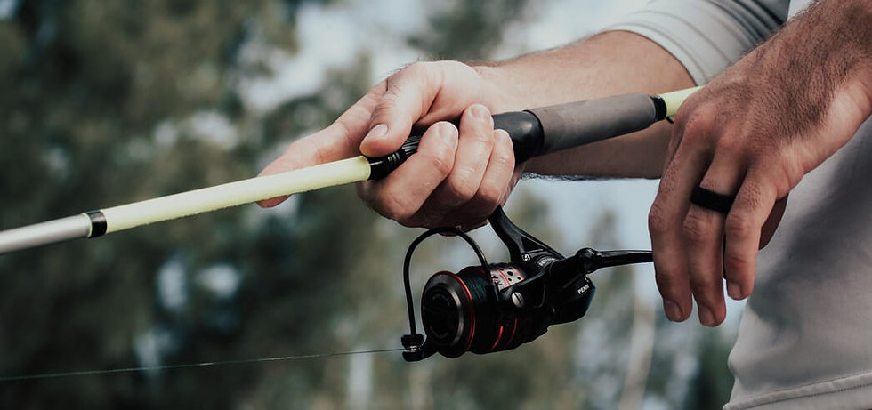 angler_holding_fishing_tackle_rod_and_re