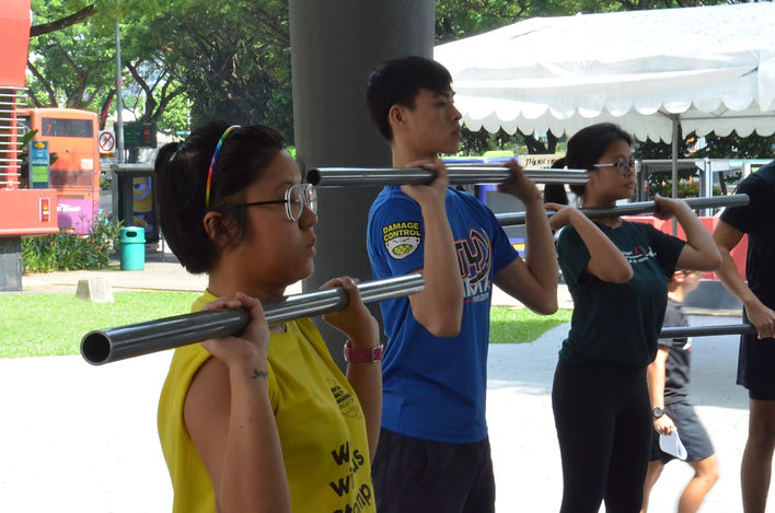 Teenagers learning the basics of CrossFit